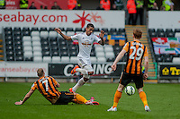 SWANSEA, WALES - APRIL 04:Kyle Naughton of Swansea city is brought down David Meyler of Hull City   during the Premier League match between Swansea City and Hull City at Liberty Stadium on April 04, 2015 in Swansea, Wales.  (photo by Athena Pictures)