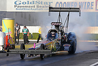 Feb. 14, 2013; Pomona, CA, USA; NHRA top fuel dragster driver Leah Pruett during qualifying for the Winternationals at Auto Club Raceway at Pomona.. Mandatory Credit: Mark J. Rebilas-
