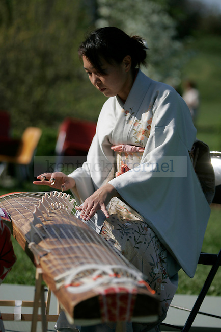 A Japanese harp is played during the Georgetown International Kite and Culture Festival on Saturday, April 17, 2010. The sounds of the Japanese harp are synonymous with Japanese culture.  Photo by Scott Hannigan | Staff