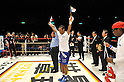 Celestino Caballero (PAN), DECEMBER 31, 2011 - Boxing : Celestino Caballero of Panama celebrates as the referee declares him the victor over Satoshi Hosono (hidden) of Japan in their WBA featherweight title bout at Yokohama Cultural Gymnasium in Kanagawa, Japan. (Photo by Hiroaki Yamaguchi/AFLO)