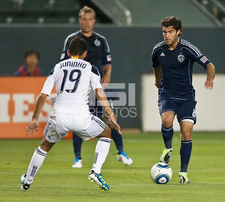 CARSON, CA – May 14, 2011: Sporting KC forward Graham Zusi (8) attempts to get the ball past LA Galaxy midfielder Juninho (19) during the match between LA Galaxy and Sporting Kansas City at the Home Depot Center in Carson, California. Final score LA Galaxy 4, Sporting Kansas City 1.