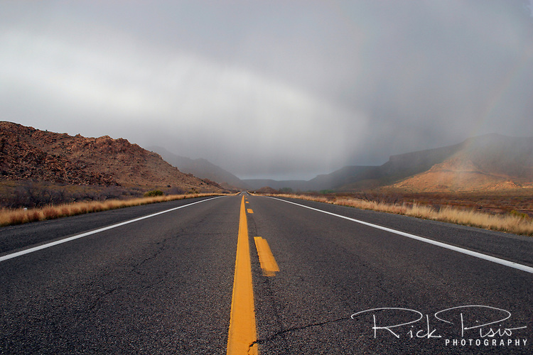 Rain squalls and rainbows pass over Route 66 in Arizona, near the small town of Truxton. Photographed 03/07