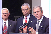 Washington, DC - September 24,  2001 -- United States President George W. Bush announces an Executive Order directing financial institutions to put a freeze on the assets of certain entities that may be fronts for terrorist activities. Left to right: U.S. Secretary of Treasury Paul O'Neill, U.S. Secretary of State Colin Powell, President Bush..Credit: Ron Sachs / CNP