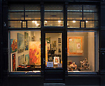 Brightly lit art gallery shop at night Dordrecht, Netherlands
