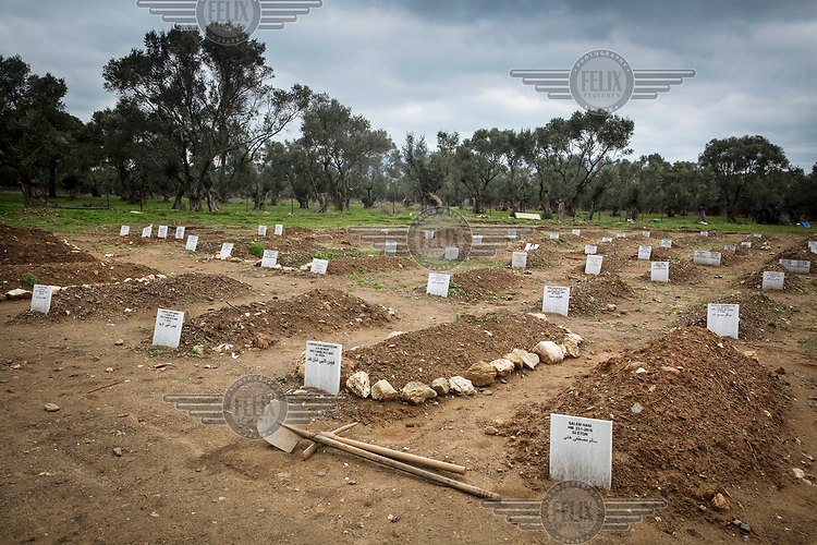 Following their burial in Kata Tritos Cemetery, small and temporary headstones are placed on the graves of migrants whose lives were lost making the Aegean Sea crossing from Turkey.