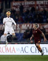 Calcio, Serie A: Roma vs Milan. Roma, stadio Olimpico, 12 dicembre 2016.<br /> Milan's Manuel Locatelli, left, heads the ball past Roma&rsquo;s Radja Nainggolan during the Italian Serie A football match between Roma and AC Milan at Rome's Olympic stadium, 12 December 2016.<br /> UPDATE IMAGES PRESS/Isabella Bonotto