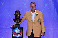 Canton, OH - August 6, 2016: Former NFL player Brett Favre poses with his bust after giving his speech at the Pro Football Hall of Fame Enshrinement Ceremony in Canton, Ohio, August 6, 2016.  Favre played 20 seasons in the NFL and retired as the NFL's all-time leading passer with 6,300 completions, 10,169 attempts, 71,838 yards and 508 TDs(Photo by Don Baxter/Media Images International)
