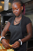 La Follette sophomore Shemekia Graham prepares hors d'oeuvres for the staff of the new Goodman Atwood Community Center on Wednesday, August 20, 2008 as part of a program for area youth to learn culinary skills
