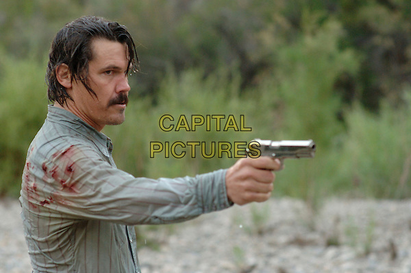 JOSH BROLIN.in No Country for Old Men .**Editorial Use Only**.CAP/FB.Supplied by Capital Pictures