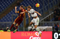 Calcio, Serie A: Roma vs Milan. Roma, stadio Olimpico, 9 gennaio 2016.<br /> Roma's Lucas Digne, left, and AC Milan's Keisuke Honda jump for the ball during the Italian Serie A football match between Roma and Milan at Rome's Olympic stadium, 9 January 2016.<br /> UPDATE IMAGES PRESS/Riccardo De Luca