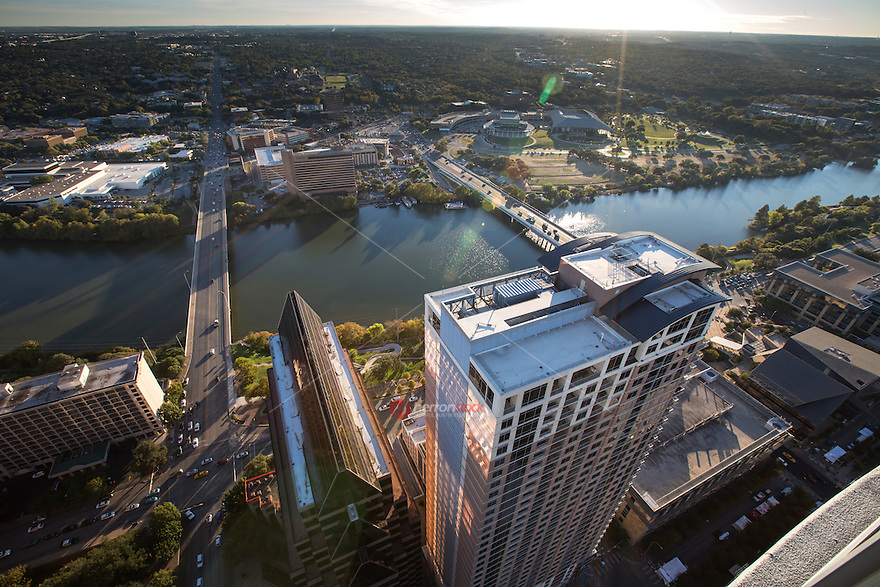 Aerial view on a clear day finds the Austin Skyline including Lady Bird Lake and the Congress Ave. and South 1st Street Bridge.
