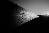 Agua Prieta.Mexico.October 22, 2006..The border fence at sunrise from the Mexican side of the border. The fence is to deter immigrants from entering the USA illegally near the Douglas port of entry.