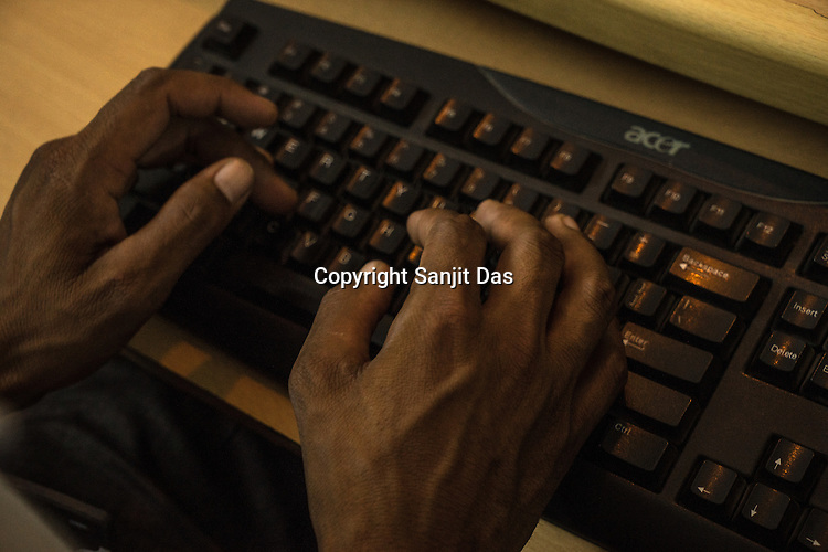 A student types and practices an instructional curriculum for typing lessons for the deaf student in a classroom at the Noida Deaf Society in Noida, Uttar Pradesh, India.