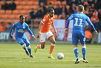Blackpool's Nathan Delfouneso under pressure from Peterborough United's Siriki Dembele<br /> <br /> Photographer Kevin Barnes/CameraSport<br /> <br /> The EFL Sky Bet League One - Blackpool v Peterborough United - Saturday 13th April 2019 - Bloomfield Road - Blackpool<br /> <br /> World Copyright &copy; 2019 CameraSport. All rights reserved. 43 Linden Ave. Countesthorpe. Leicester. England. LE8 5PG - Tel: +44 (0) 116 277 4147 - admin@camerasport.com - www.camerasport.com