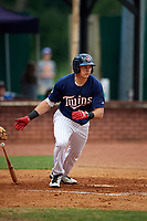 Elizabethton Twins designated hitter Trevor Larnach (9) follows through on a swing during a game against the Bristol Pirates on July 29, 2018 at Joe O'Brien Field in Elizabethton, Tennessee.  Bristol defeated Elizabethton 7-4.  (Mike Janes/Four Seam Images)