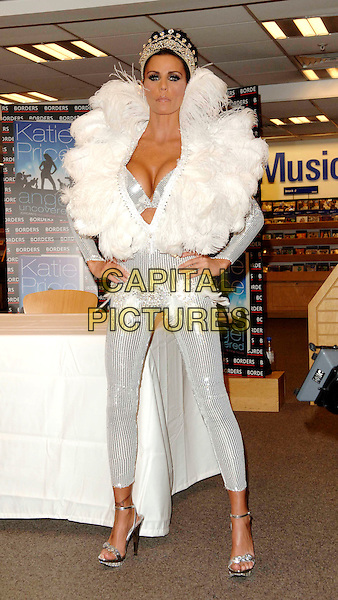 "JORDAN - KATIE PRICE .Launches her new book ""Angel Uncovered"" at Borders book store, London, England. .July 17th, 2008 .full length silver sequins sequined feathers feathered collar jewel encrusted crown plunging neckline cleavage bra catsuit jumpsuit hands on hips belt funny face.CAP/WIZ.© Wizard/Capital Pictures."