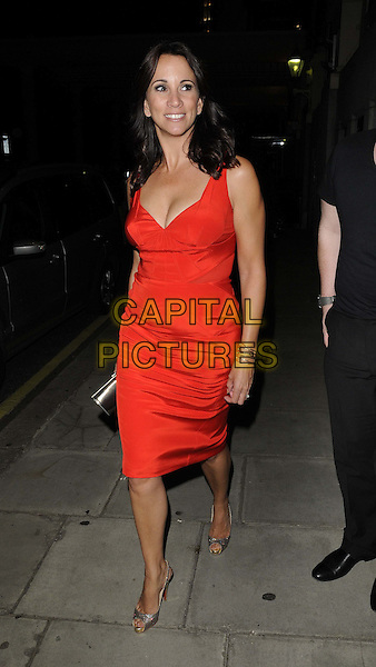 ANDREA McLEAN .TV Choice Awards 2011 departures held at the Savoy Hotel, London, England..September 13th, 2011.full length red sleeveless dress.CAP/CAN.©Can Nguyen/Capital Pictures.