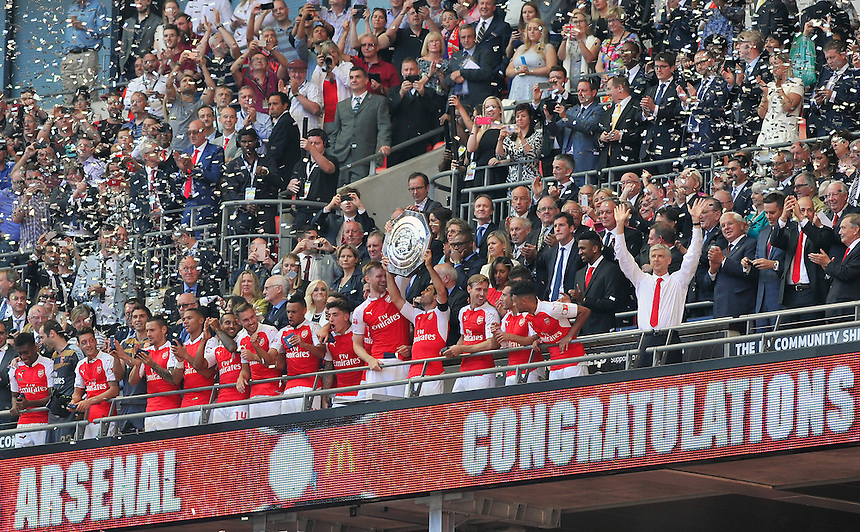 Arsenal manager Ars&egrave;ne Wenger (right) and his team celebrate as they defeat Chelsea 1-0 in the FA Community Shield<br /> <br /> Photographer Ashley Western/CameraSport<br /> <br /> Football - FA Community Shield - Arsenal v Chelsea - Sunday 2nd August 2015 - Wembley Stadium - London<br /> <br /> &copy; CameraSport - 43 Linden Ave. Countesthorpe. Leicester. England. LE8 5PG - Tel: +44 (0) 116 277 4147 - admin@camerasport.com - www.camerasport.com
