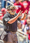 27 April 2014: MLB Umpire Marvin Hudson shows the count during a game between the Washington Nationals and the San Diego Padres at Nationals Park in Washington, DC. The Padres defeated the Nationals 4-2 to to split their 4-game series. Mandatory Credit: Ed Wolfstein Photo *** RAW (NEF) Image File Available ***