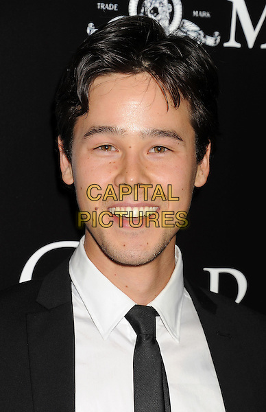 Philip Nozuka<br /> &quot;Carrie&quot; Los Angeles Premiere held at Arclight Cinemas, Hollywood, California, USA.<br /> October 7th, 2013<br /> headshot portrait black white shirt tie suit<br /> CAP/ROT/TM<br /> &copy;Tony Michaels/Roth Stock/Capital Pictures