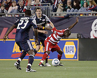 FC Dallas defender Jair Benitez (5) reacts to a tackle by New England Revolution midfielder Marko Perovic (29).  The New England Revolution drew FC Dallas 1-1, at Gillette Stadium on May 1, 2010
