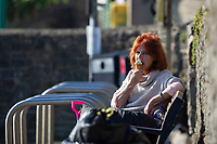 WEATHER PICTURE WALES<br /> A lady enjoys a ice cream during the unusually warm weather in Langland Bay near Swansea, Wales, UK. Wednesday 27 February 2019