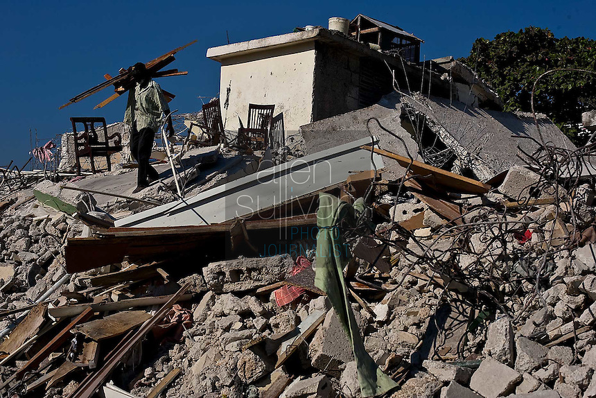 A man salvages wood from a destroyed Port-au-Prince building. The 7.0 earthquake that devastated parts of Haiti on January 12 killed hundreds of thousands of people. January's earthquake killed hundreds of thousands of people and caused significant and lasting structural and economic damage in the Caribbean nation.