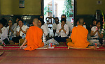 Buddhist monks lead devotees in prayer