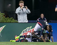 Foxborough, Massachusetts - July 9, 2016: In a Major League Soccer (MLS) match, the New England Revolution (blue/white) defeated Columbus Crew (yellow/white/blue), 3-1,at Gillette Stadium.<br /> Goal celebration.