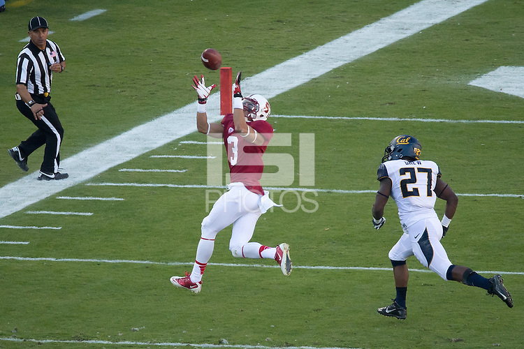 Stanford, CA -- November 23, 2013:  Stanford's Michael Rector makes a reception during a game against Cal at Stanford Stadium. Stanford defeated Cal 63-13.