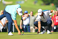 Haydn Porteous and David Howell lay down their markers on the 2nd green during the BMW PGA Golf Championship at Wentworth Golf Course, Wentworth Drive, Virginia Water, England on 25 May 2017. Photo by Steve McCarthy/PRiME Media Images.
