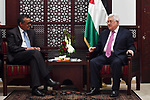 Palestinian President Mahmoud Abbas meets with the chief of the World Health Organization (WHO) Tadros Ohanum, at his headquarters in the West Bank city of Ramallah on March 15, 2018. Photo by Thaer Ganaim