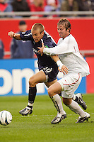 The MetroStars' Jeff Parke attempts to hold back the  New England Revolution's Taylor Twellman as he breaks to the goal. The New England Revolution tied the NY/NJ MetroStars one all at Gillette Stadium, Foxborough, MA, on May 22, 2004.