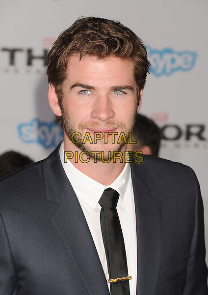HOLLYWOOD, CA - NOVEMBER 04: Liam Hemsworth at the Los Angeles Premiere 'Thor: The Dark World' at the El Capitan Theatre on November 4, 2013 in Hollywood, California, USA.<br /> CAP/ROT/TM<br /> &copy;Tony Michaels/Roth Stock/Capital Pictures