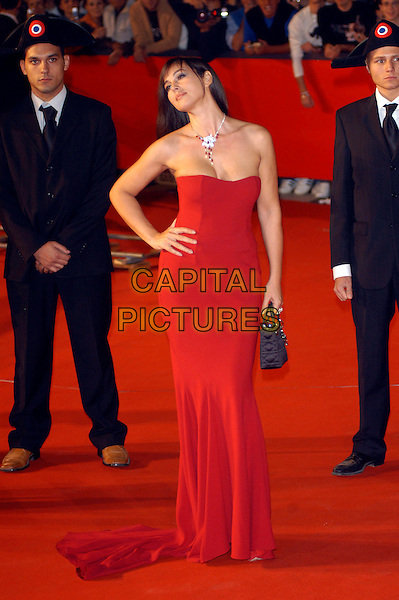 "MONICA BELLUCCI.Attends the Red Carpet Premiere of ""N (Io e Napoleone)"".during the Rome film Festival,.Rome, Italy, October 14th 2006..full  length red dress strapless hand on hip necklace.Ref: CAV.www.capitalpictures.com.sales@capitalpictures.com.©Luca Cavallari/Capital Pictures."