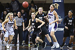 SIOUX FALLS, SD: MARCH 19: Lauren Wolosik #24 of Indiana (PA) and Courtney Walsh #2 of Stonehill concentrate on a loose ball during their game at the 2018 Division II Women's Elite 8 Basketball Championship at the Sanford Pentagon in Sioux Falls, S.D. (Photo by Dick Carlson/Inertia)