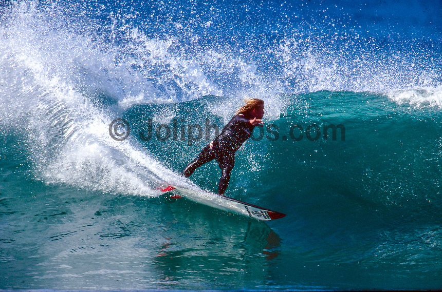Jeffreys Bay, Eastern Cape, South Africa circa1991. <br /> Matt Hoy (AUS)  on his Maltese Cross spray surfboard surfing Jeffreys Bay during the running of the Country Feeling Dream Sequence surf contest. The concept for the unique Dream Sequence event was created by former pro surfer Derek Hynd (AUS) and it was won by  Luke Egan (Aus) with the first prize being a block of land over looking the iconic surf break. Photo:joliphotos.com