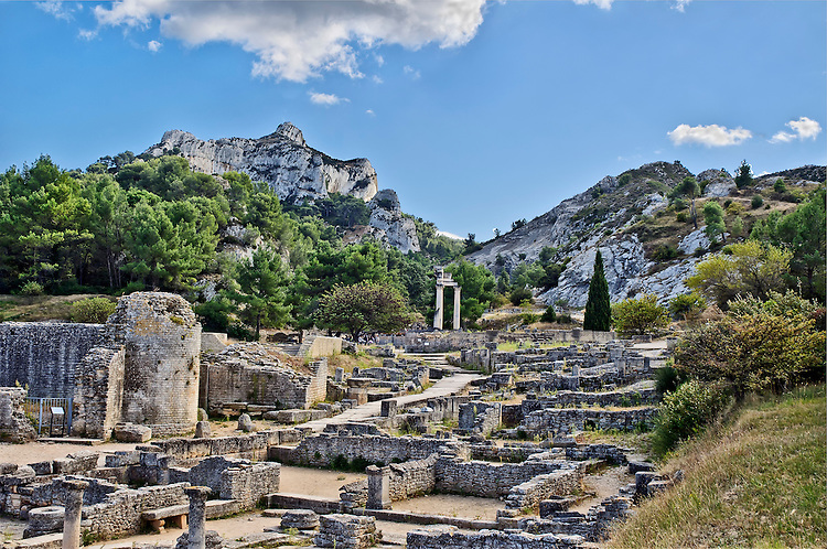 A view of Mont Gaussier and other Alpilles. A portion of the excavations of the ancient Roman town of Glanum appears in the foreground.