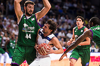 Real Madrid's player Sergio Llull and Unicaja Malaga's player Dejan Musli and Oliver Lafayette during match of Liga Endesa at Barclaycard Center in Madrid. September 30, Spain. 2016. (ALTERPHOTOS/BorjaB.Hojas) /NORTEPHOTO