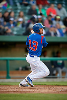 South Bend Cubs first baseman Jhonny Pereda (13) follows through on a swing during a game against the Clinton LumberKings on May 5, 2017 at Four Winds Field in South Bend, Indiana.  South Bend defeated Clinton 7-6 in nineteen innings.  (Mike Janes/Four Seam Images)