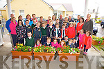 Pupils, staff & parents from Aghatubrid NS making a presentation of flower boxes on Monday to St Anne's Hospital Cahersiveen, the project was funded by Cahersiveen Tidy Towns and Cahersiveen Congress, the project is also part of the schools Green Flag Program.