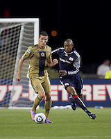 Philadelphia Union forward Sebastien Le Toux (9) dribbles the ball as New England Revolution defender Cory Gibbs (12) pressures. The Philadelphia Union defeated New England Revolution, 2-1, at Gillette Stadium on August 28, 2010.