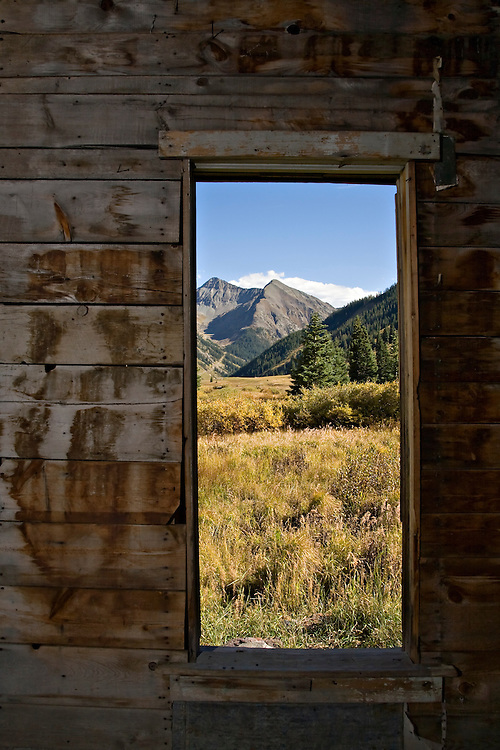 From the window of an abandoned building, a view of the mountains surrounding the Animas Forks ghost town