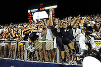 17 September 2011:  FIU quarterback Wesley Carroll (13) climbs into the stands to celebrate with fans after the FIU Golden Panthers defeated the University of Central Florida Golden Knights, 17-10, at FIU Stadium in Miami, Florida.