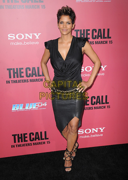 Halle Berry.'The Call' world film premiere, Arclight Cinemas, Hollywood, California, USA. 5th March 2013.full length black cowl neck top leather skirt gold belt sandals hands on hips.CAP/DVS.©DVS/Capital Pictures