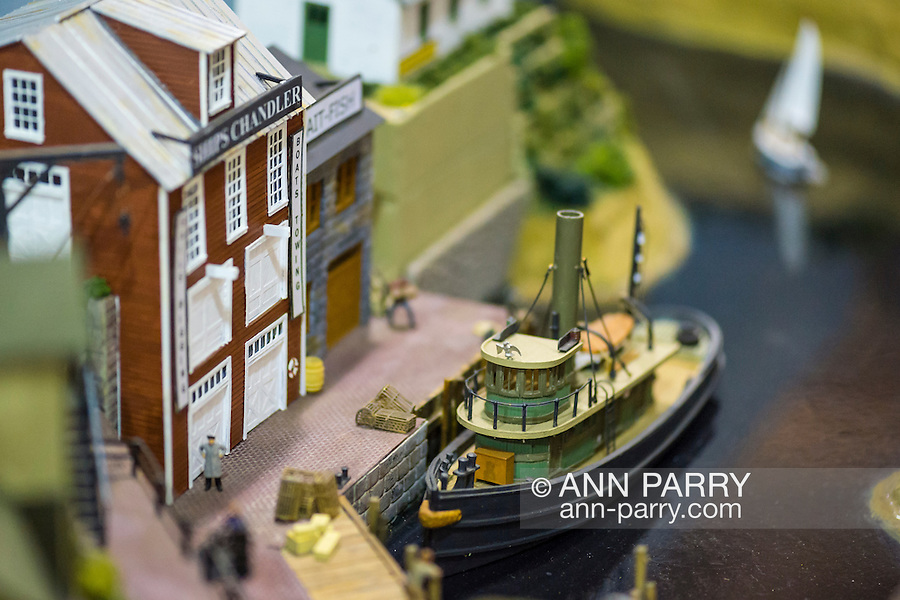 Hicksville, New York, USA. February 22, 2015. An old fashioned dock scene with model boat and marine buildings displayed at the Model Train Exhibit hosted by Trainville Hobby Depot at the Broadway Mall. Donations were accepted at exhibit to support the Nassau County Empire State Games for the Physically Challenged.