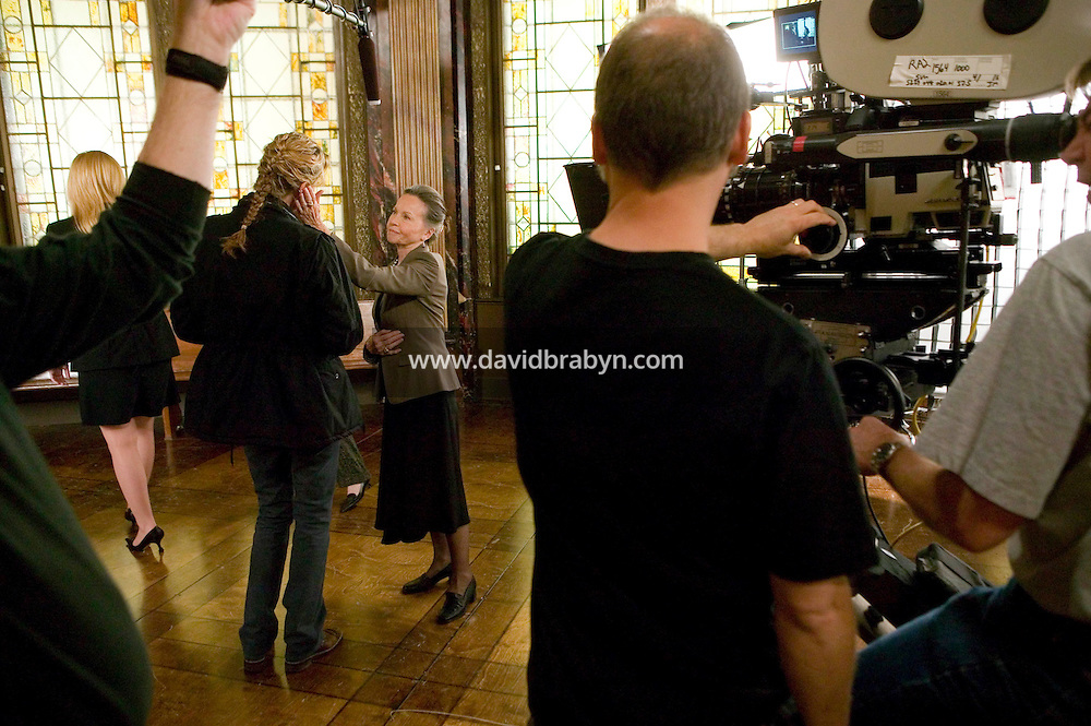 "8 May 2006 - North Bergen, NJ - French actress Leslie Caron (2R), Connie Nielsen (3L), Diane Neal (2L) and Lily Rabe (4L) rehearse a scene on the studio set of television show ""Law & Order: SVU"" in North Bergen, USA, 8 May 2006. In this rare appearance in front of American television cameras, Caron, 74, plays a French victim of past sexual molestation in an episode entitled ""Recall"" due to air in the fall. Caron starred in Hollywood classics such as ""An American in Paris"" (1951), ""Lili"" (1953), ""Gigi"" (1958). More recently she appeared in ""Chocolat"" (2000) and ""Le Divorce"" (2003). Photo Credit: David Brabyn"