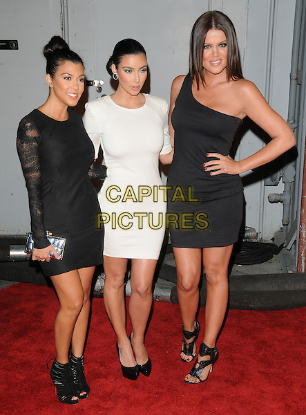 KOURTNEY KARDASHIAN, KIM KARDASHIAN & KHLOE KARDASHIAN.The Maxim's Hot 100 List Party held at Barker Hangar in Santa Monica, California, USA..May 13th, 2009.full length white dress hand on hip black platform shoes clutch bag sculpted shoulders lace one shoulder sisters siblings family silver open toe .CAP/DVS.©Debbie VanStory/Capital Pictures.