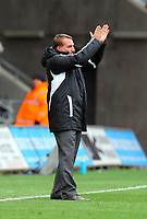 FAO SPORTS PICTURE DESK<br /> Pictured: Brendan Rodgers thanking home supporters after the final whiste. Saturday, 14 April 2012<br /> Re: Premier League football, Swansea City FC v Blackburn Rovers at the Liberty Stadium, south Wales.