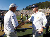 California head coach Jeff Tedford shakes hands with UCLA head coach Rick Neuheisel after the game at Memorial Stadium in Berkeley, California on October 9th, 2010.   California defeated UCLA, 35-7.